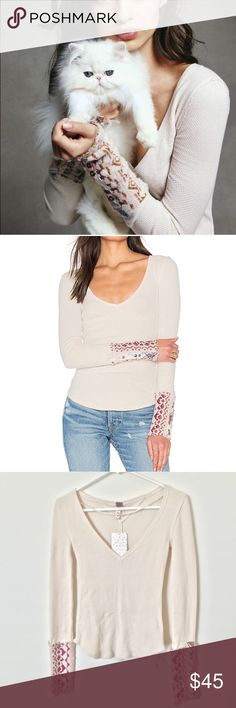"""Free People Art School Cuff Thermal Long sleeve tee with a lived-in look and a relaxed feel. Features uniquely printed bohemian sleeve cuffs with decorative buttons. V-neckline and easy, rounded hem. So comfy and stretchy fabrication.  Approx. 21"""" from shoulder to hem.  Armpit to armpit approx. 13 1/2"""" across laying flat.  Body is 57% cotton, 38% polyester, 5% spandex. Sleeves are 53% nylon, 20% acrylic, 17% merino wool, 4% spandex Free People Tops"""