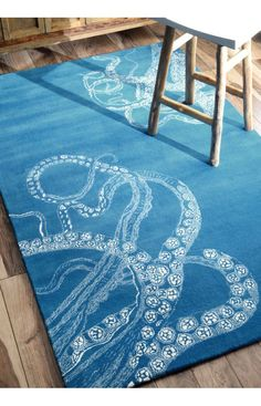 Featuring Rugs USA's Octopus Rug. Woven of wool with the legs of the Octopus in faux silk. Available in a variety of colors and sizes.