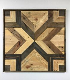This is a VERY LARGE hand-made wall hanging made from recycled pallet wood.