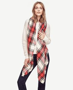 A fresh spin on the heritage print, this tartan scarf tops our season's checklist. Light fringe at ends.
