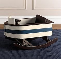 Boat rocking horse. Restoration hardware no longer carries it but maybe papa could make one someday!