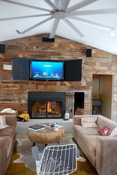 Hidden TV in fireplace wall.