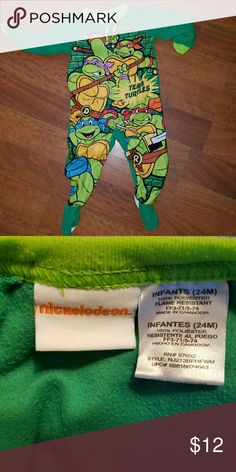 Nickelodeon Teenage Mutant Turtles Footed Pajamas Excellent condition! Great colorful footed jammies for your little one. Popular Teenage Mutant Turtles! Brand: Nickelodeon Size 24 Months Color: Mostly Greens Nickelodeon Pajamas
