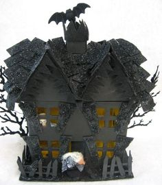 make a little haunted house - I'd use a ready-made wooden house from Michael's