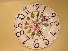 Family kitchen clock made at Glazydayz pottery studio in Ledbury. Used family finger prints to make the various flower and tree shapes, designed and painted etc on to a plate. https://www.facebook.com/pages/Glazydayz-Pottery-painting-studio/125380057496953?fref=ts