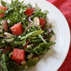 Watermelon arugula salad with walnuts, red onions and feta cheese