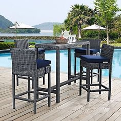 Featuring a bar table and 4 high chairs, the 5-Piece Summon Outdoor Pub Set from Modway is perfect on the patio or poolside. Outfitted with durable Sunbrella cushions, synthetic rattan weave, UV protection, and a powder-coated aluminum frame.