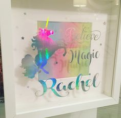 Iridescent rainbow unicorn frame. Fully personalised. Catches the light perfectly ! Available from Tartan Lily Designs on Facebook. £18 www.facebook.com/thetartanlily Unicorn Rooms, Unicorn Room Decor, Box Frame Art, Deep Box Frames, Unicorn Birthday Parties, Unicorn Party, Mermaid Room, Unicorns And Mermaids, Rainbow Room