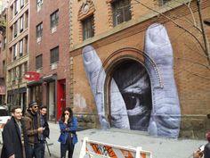Paris based artist JR - new work - 11 Spring St & Elizabeth-  Street art alive in NYC. Via Art Observed.