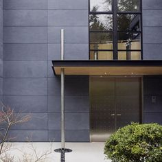 """by Jim Burton Architects  """"Hi - It's a European cement-board panel product called Cembonit. It has integral color, meaning it doesn't need painting like Hardi-panel. A similar product called Silbonit has the same properties, and is made in the U.S. They are more expensive than typical cement-board products"""""""