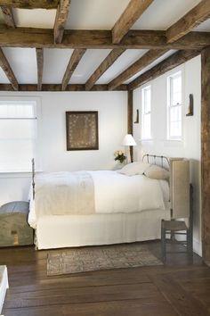 Natural wood beams and white walls.