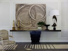 Jean Louis Deniot, antique with modern.  Love this console!  Love the huge art, off center and the lamp to balance.  LOVE!