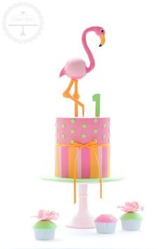 Bright and playful first birthday cake with flamingo handcrafted from fondant