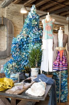 Anthropologie Display: the blue cones surrounding the base and creating a vine wrap around. Maybe for our cork board display? Or too girly? Maybe an underwater theme?
