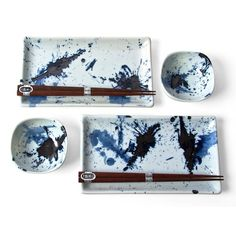 Lively splashes of glaze create a playful pattern across the Blue Sumi Sushi set. Presented in an attractive box, the set makes a beautiful gift for any lover of Japanese cuisine. Includes: 2 Rectangular plates 2 Sauce dishes 2 Pairs of chopsticks Japanese Plates, Japanese Ceramics, Japanese Table, Blue Dinner Plates, Blue Plates, Ceramic Tableware, Ceramic Pottery, Kitchenware, Pottery Bowls