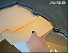 Great tip for painting mirror frame. Shove cardstock under edges. No time consuming taping involved! brilliant!!
