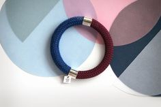 £24 MAE bracelets, made from knitted and crochet cotton/polyester, are designed by Sarah Mesritz