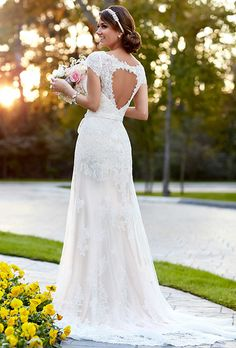 18d9a40555a Brides  Stella York. More Details From Stella York This dress has a sexy v