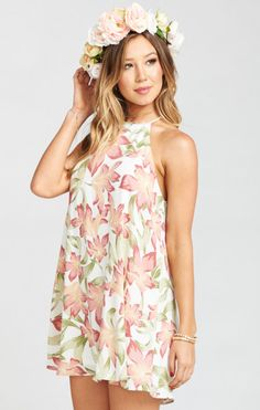 Short and sweet bridesmaid style! We're swooning over this high-neckline bridesmaids dress with a summer floral pattern from Show Me Your MuMu.   Bridal Party Fashion   Wedding Party Style   Short Bridesmaid Dresses