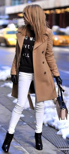 Camel pea coat, black sweater, ankle boots and white skinny pants.