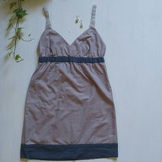 Gap Sundress Gap Sundress ------------------------ *Mauve & navy w/ silvery ribbon straps  *Empire waist and side pockets *100% Cotton.  *Re-poshing: worn once but it's too big for to keep *Excellent Condition GAP Dresses