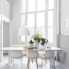 How beautiful is this white dining room Normann Copenhagen Bell lamp available in our online store . Image via loftloft.nl #diningroom #diningroomdecor #nordichome #nordicinspiration