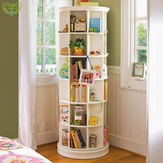 Furniture, High And Narrow Revolving Bookcase Kids With Furniture And Toy Storage Painted With White Color Beside Window In The Small Corner Kids Room Spaces Ideas ~ Kids Bookcase