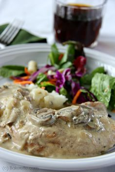 These pork chops and mushrooms are smothered in a savory white wine sauce and simmered to perfection in the Crock Pot. Bakerette.com