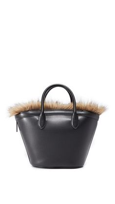 Faux fur lining adds a lush appeal to this tapered Vasic Collection tote. Optional slim zip pouch. Rolled handles. Dust bag included.