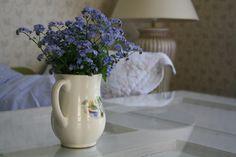 Myosotis, wild flowers in an old Arabia vase