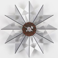 The Flock of Butterflies is a large geometric wall clock made made from…