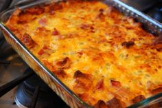 Breakfast Strata that ROCKS It's full of ham and cheddar and more cheddar! Easy to make and fast to disappear!