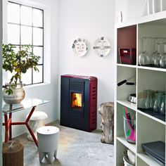 Flat, Flair, Philo and Tube stoves by MCZ: these space-saving stoves by fireplace manufacturers MCZ are designed to fit into tight spaces.  I wish they would sell these in the U.S.