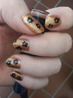 Black flower nails. I used dotting tools to make these.