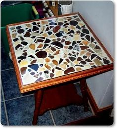 Sea Glass Coffee Table: ~ sea glass project submitted by Mona in Maine, USA   I glued the pieces down with ceramic tile glue and then grouted around them.  My husband made a...  Read more: http://www.odysseyseaglass.com/sea-glass-coffee-table.html