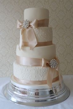 Lace applique detailing & wide ribbon  Love this cake but with different colored ribbon