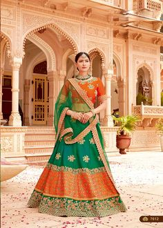 Stylish Green And Orange Jacquard Silk Thread And Cord Embroidery Wedding Wear Lehenga Choli This pretty piece is a fairy tale that begins to unfold as you reveal your beauty in it. Look Stunningly beautiful in this green and orange color lehenga. Party Wear Lehenga, Bridal Lehenga Choli, Lehenga Saree, Wedding Lehnga, Orange Lehnga, Green Lehenga, Indian Attire, Indian Outfits, Indian Clothes