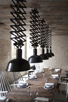 Scissor lamps, I love it. I think they would be fun in a space where they could be adjusted for mood.