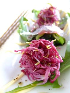 Chysanthemum Flower Salad: edible chrysanthemum, mizuna leaves, seaweed, mayonnaise, olive oil, black pepper, salt.