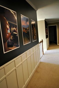 Black hallway gallery wall with wainscoting