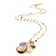 This luxurious layering necklace on ombre zircon chain features a delicious cognac quartz focal stone surrounded by a cluster of charcoal druzy quartz, rutilated quartz, and a fawn fresh water pearl. A fusion of our favorite earthen hues, this piece is destined to become one of your top picks. - Robindira Unsworth