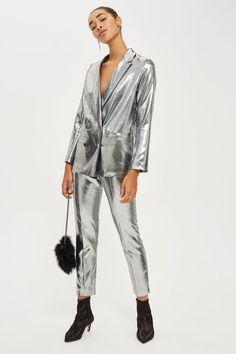 Silver metallic double breasted suit jacket.