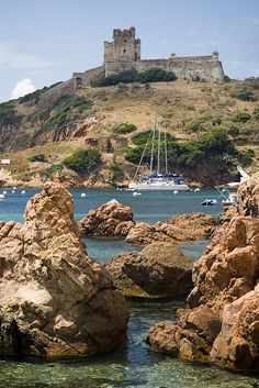 Corsica: Formerly a Genoese tower later rebuilt into citadel above the port of #Girolata.