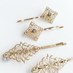 Victorian inspired filigree hair pin set features 4 separate pieces that all stack together to create a beautiful styling accent. Each pin is decorated with CZ stones for extra glimmer. The larger hair pin filigree motif is 1 long. 4 pieces come with one order.