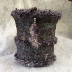 Felted vessel with mohair trim and northern Michigan stone.