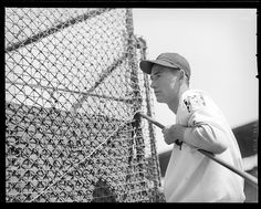 Red Sox rookie Ted Williams leaning on the batting cage at Fenway Park. 1939
