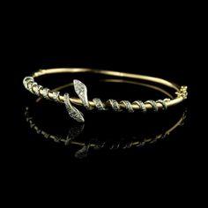 How fun is this 14K two-tone gold diamond snake bangle!