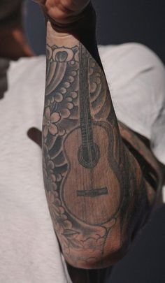 Adam Levine. Coolest guitar tat I've seen