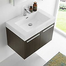 Take your bathroom from basic to beautiful with the Fresca Vista line. The trendy rectangular sink has clean lines and a bright white finish, while the contemporary Grey Oak wall mounted bathroom vanity offers superior storage, soft close doors and sleek brushed pulls. The frameless Medicine Cabinet has two doors with mirrors on both sides and two adjustable glass shelves to hold items of varying sizes. This lovely vanity and medicine cabinet is available in multiple sizes to give a chic…
