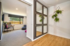 IKEA NISSEDAL mirror Entrance way Artificial succulents Resene Half Rice Cake Eijffinger Clover 331081 wallpaper